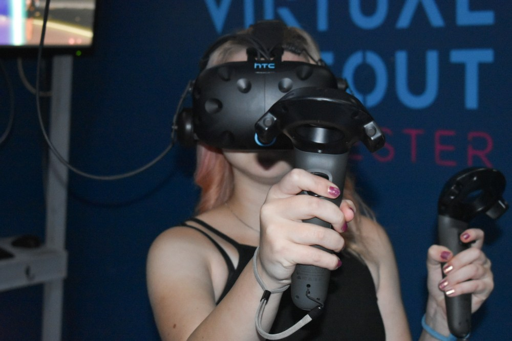 A girl in a VR headset at Virtual hideout manchester