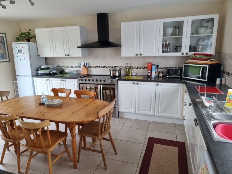 Large well equipped kitchen at Endeavour Short breaks. Lots of cupboards and work top space, fridge freezer, microwave, toaster, table and chairs