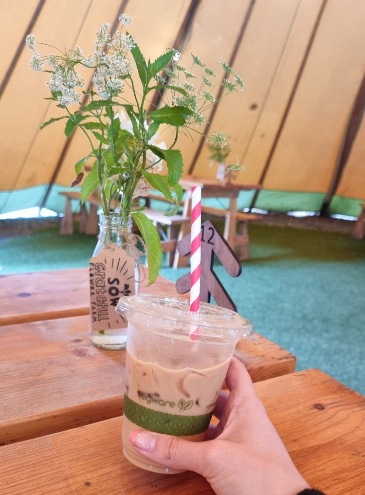 Iced coffee with flower table decoration at Fodder cafe, Finnebrogue woods