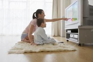 depositphotos_33842721-stock-photo-mother-and-son-watching-television