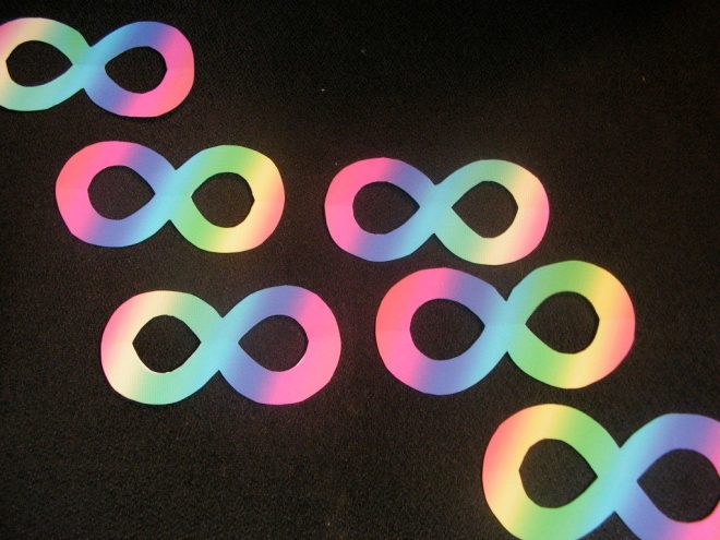 Rainbow infinity sign cut-outs on a black chair
