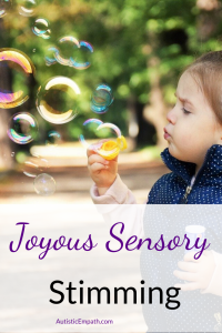 "A toddler with long dark hair, wearing a pink long sleeved shirt and a blue and white dotted puffer vest blowing bubbles. Purple and black text on a white background reads ""Joyous Sensory Stimming"""