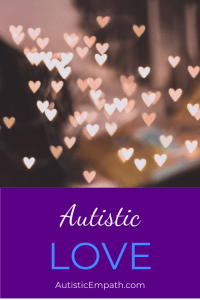 "Small hearts made of pink and white light scattered across a blurred background. White and blue text on a purple background reads ""Autistic LOVE"""