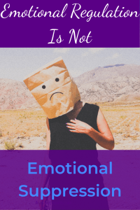 """A person in black clothes standing in a desert. They have a paper bag over their head with a rudimentary """"frowny face"""" drawn on it. White and blue text on a purple background reads """"Emotional Regulation is not Emotional Suppression"""""""