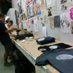 Our volunteers help us screenprint t-shirts