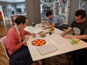 A group of Autistic adults gather at a table