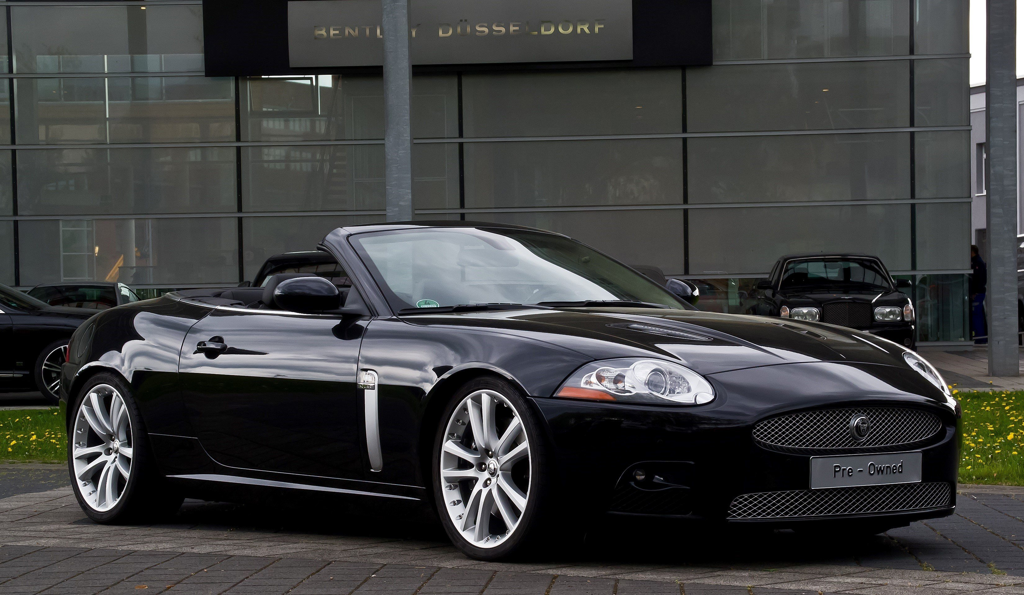 Latest Black Cabriolet Jaguar Luxury Convertible Car On Road Free Download