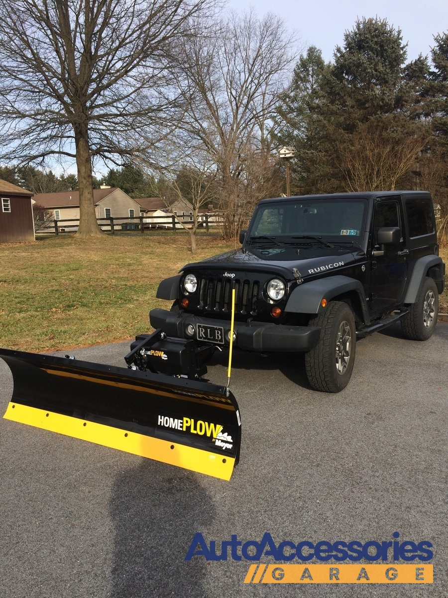 Snowsport plow with my own custom lift system on my 06 jeep grand...