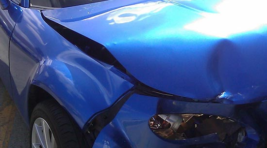 Car accident or fender bender with significant damage to vehicle