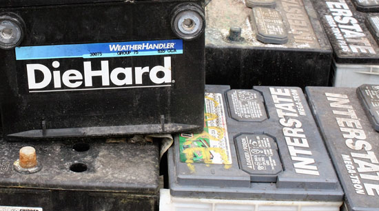 Old faulty and damaged batteries waiting to be recycled