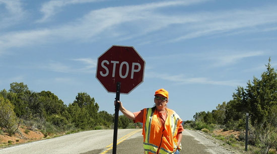 Highway driving safety work zone flagger