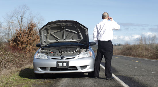 Car with dead battery stranded on roadside