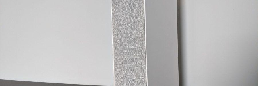 The White Ikea Symfonisk Bookshelf Speaker sitting on my brown desk