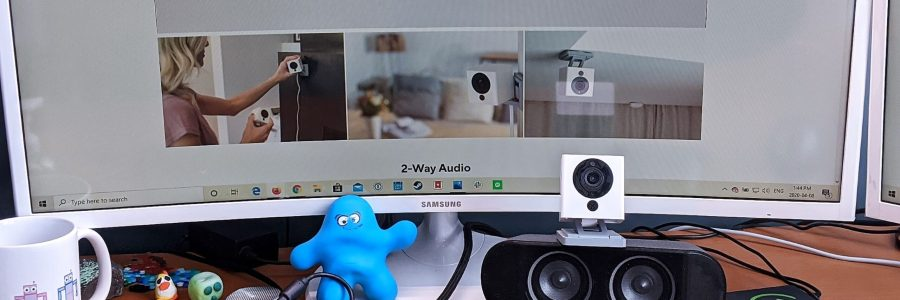 The Wyze Cam perched on my desk in front of my montior. Ready to be converted into a webcam