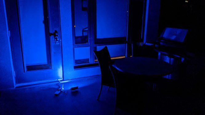 Novostella Smart LED Floodlights shining blue light against the house