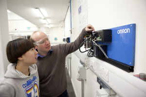 Alan-Thorne-Technical-Officer-for-the-Automation-Laboratory-and-MET-course-lecturer-demonstrates-an-Omron-PLC-to-a-student-300x200