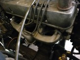 Ceramic-coated manifold and rebuilt oil cooler lines in the lower right