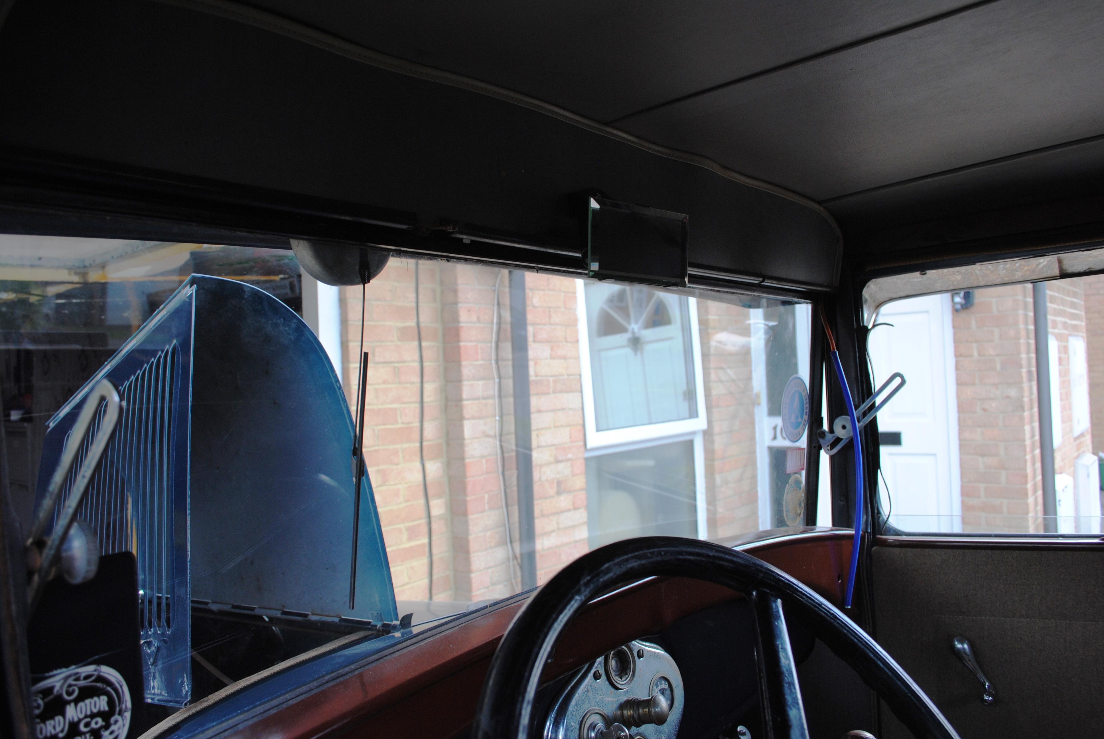 Rear view mirror and header trim