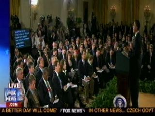 Obama speaks to the press with his new big screen teleprompter