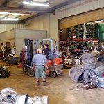 Forklift moving parts in warehouse