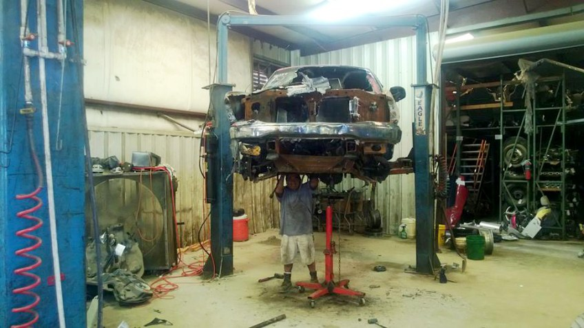 Vehicle on lift being dismantled