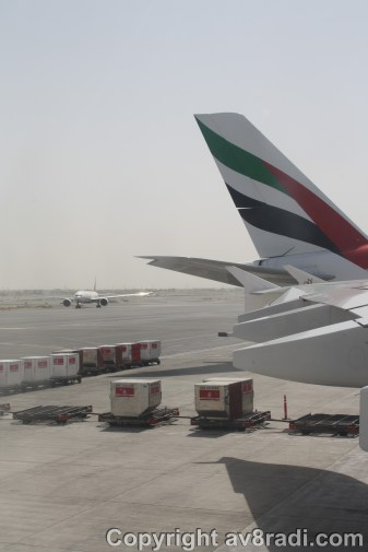 An EK's Boeing 777 taxies by