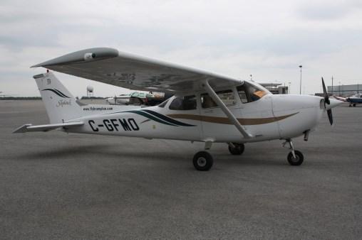 A Cessna 172, non-pressurized cabin, hence large windows