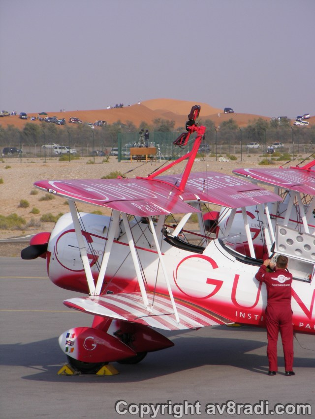 The Guinot team prepares their aircraft as Jurgis Kairys performs above