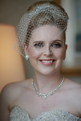 vintage inspired bride wearing birdcage veil