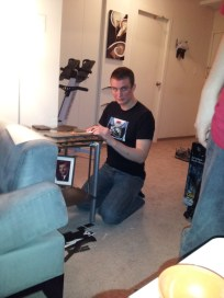 Craig (best man) is cutting paper