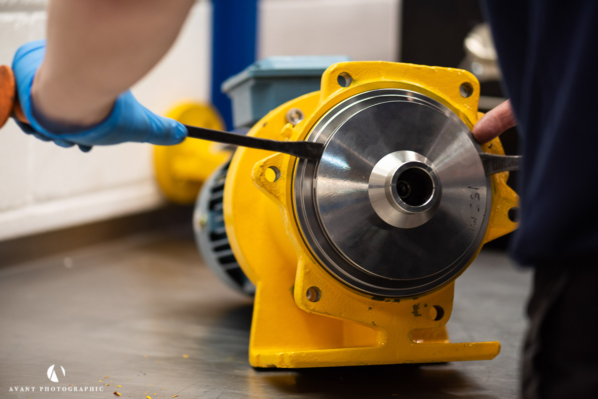 Avant Commercial photographer Phil Burrowes Day in the life photoshoot Yellow HMD Kontro Sealless pump being taken apart