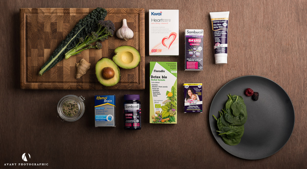 Flat lay on dark background with health products and natural ingredients