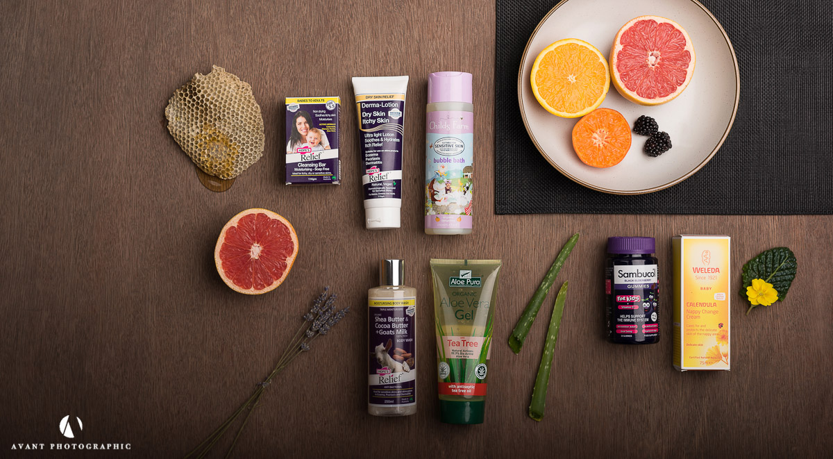 Flat lay of health products on dark background with natural ingredients