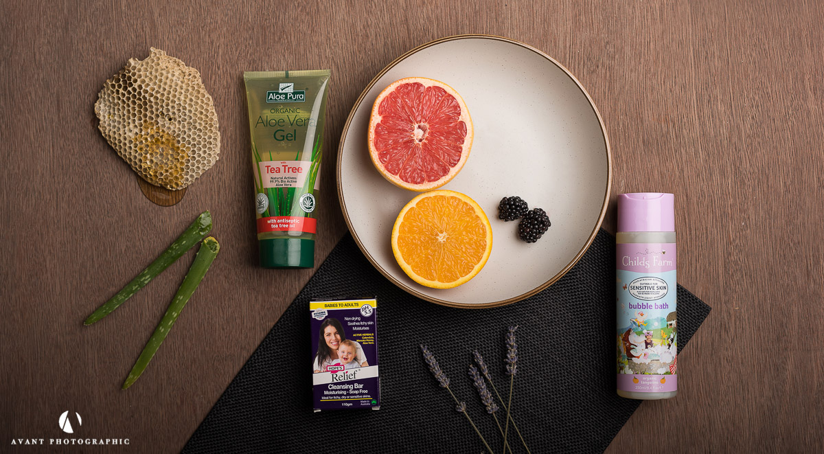 Flat lay product photography on dark background with natural ingredients