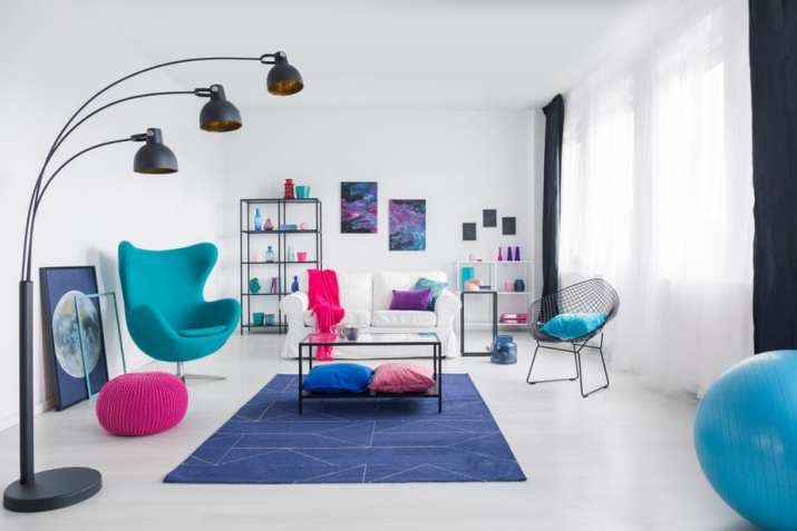 Trendy, Bright Blue Couch in Creative Space