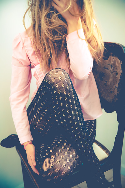woman sitting with legs crossed in patterned tights