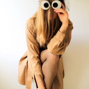 mysterious woman with fun sunglasses and fishnets