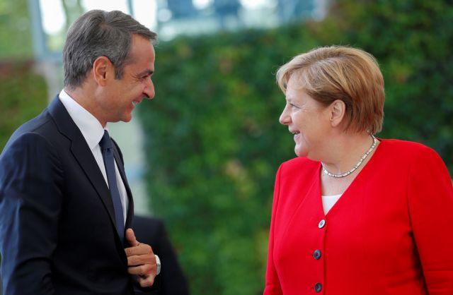 German chancellor angela merkel and greece's prime minister kyriakos mitsotakis meet in berlin