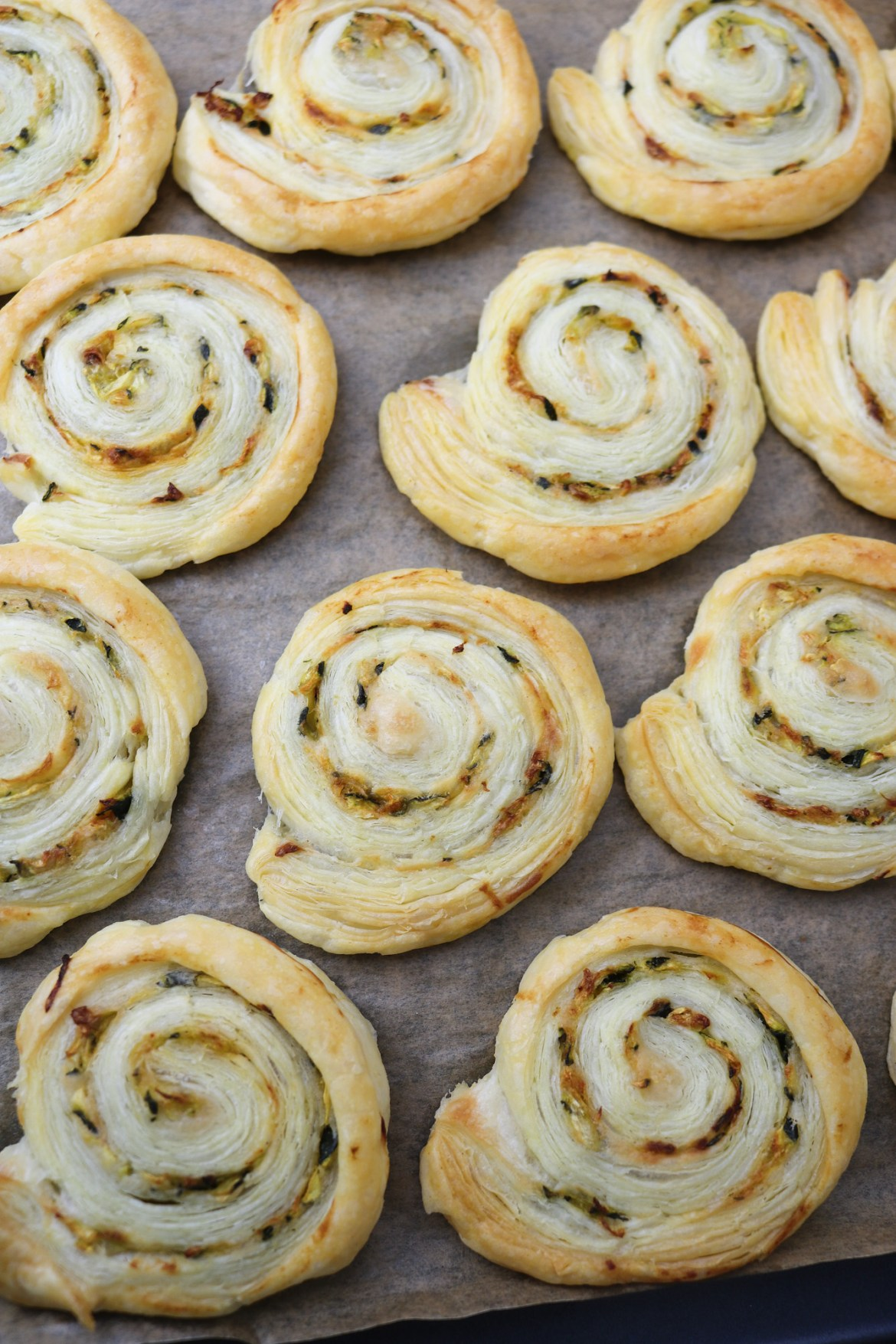 vegan courgette and smoked paprika pastry rolls on tray after bake