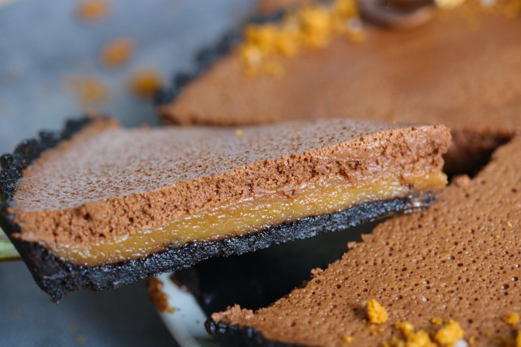 Slice of Chocolate Mousse and Biscoff Tart to show the layers