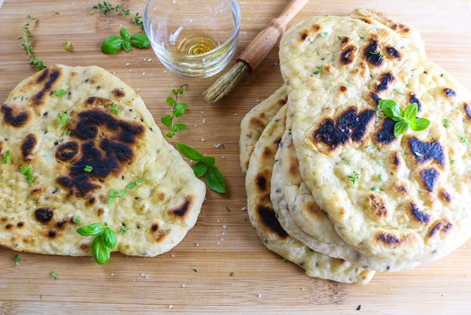 Homemade Plain Naans on wooden board