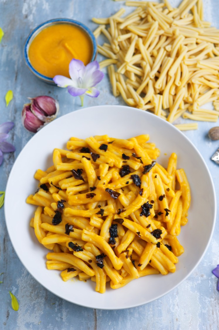 Butternut Squash Pasta with Crispy Smoked Seaweed arranged on a serving plate with other ingredients for the recipe in the background