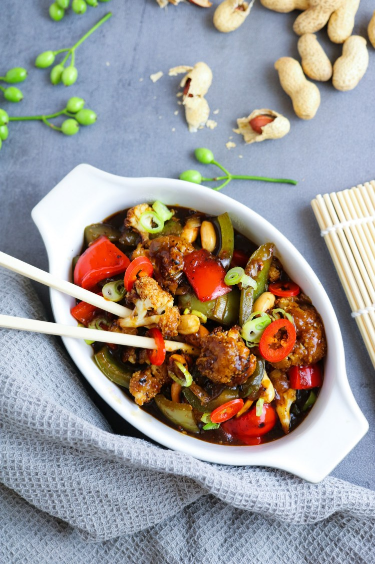 vegan and vegetarian Kung Pao Cauliflower in a white dish ready to serve