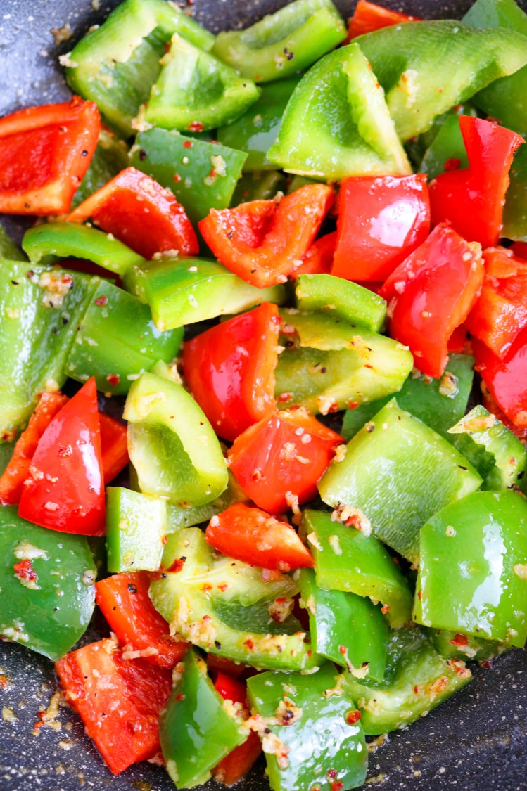 vegan and vegetarian chopped bell peppers green and red seasoned with spices and marinate for Kung Pao Cauliflower