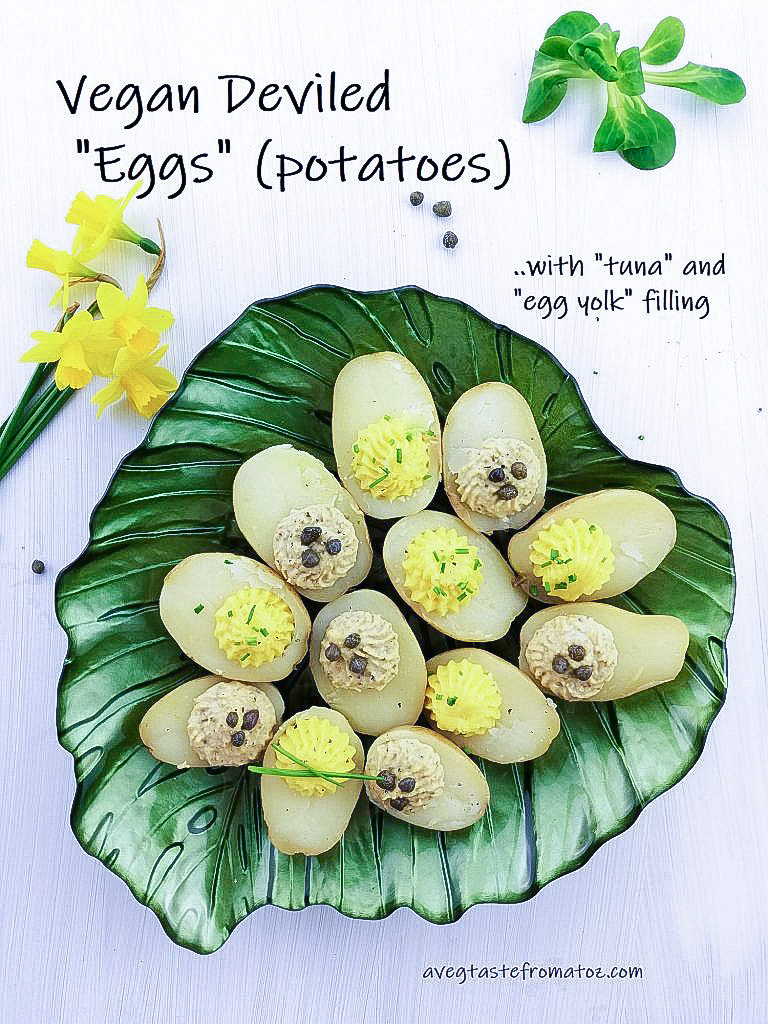 boiled potatoes with vegan tuna and egg yolk filling on a leaf shaped green plate, white background, peppercorns, lettuce and yellow flowers as decorations with black text for social media sharing