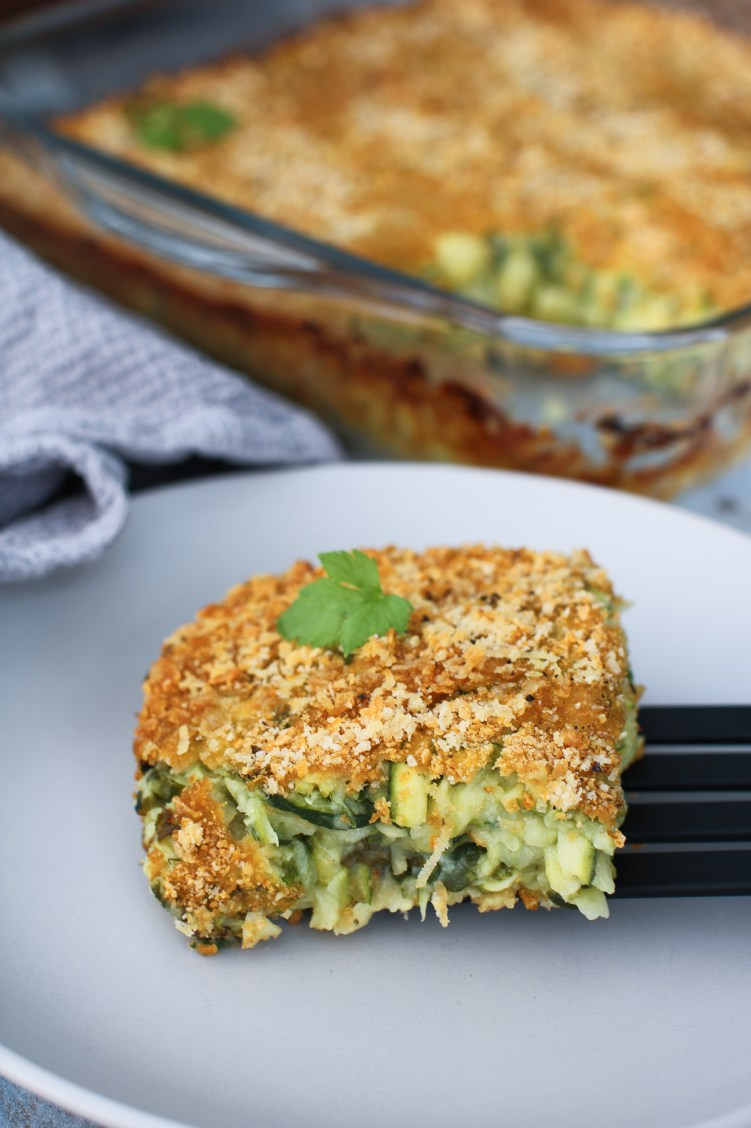 courgette baked frittata slice on spatula on a plate