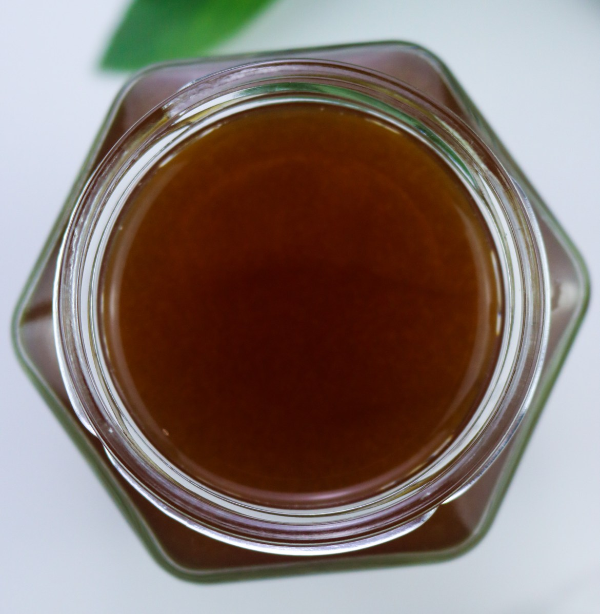 vegan fish sauce in an hexagonal glass jar