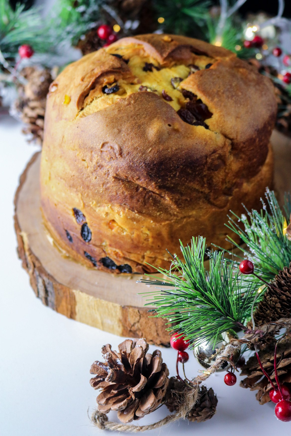 whole panettone on a wooden tray