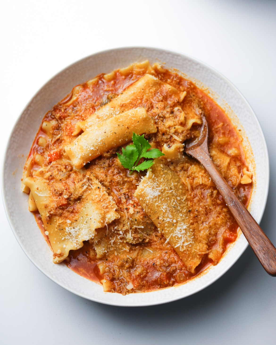 lasagna soup bowl with wooden spoon served