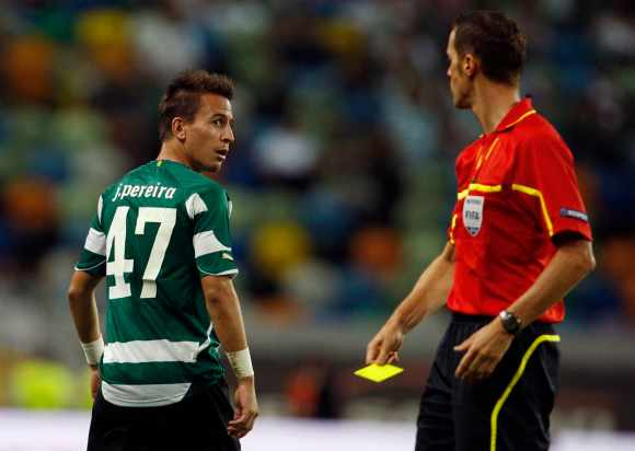 Sporting Lisbon's Pereira looks at the referee after receiving a yellow card during their Europa League play-off soccer match against Brondby at Jose Alvalade stadium in Lisbon